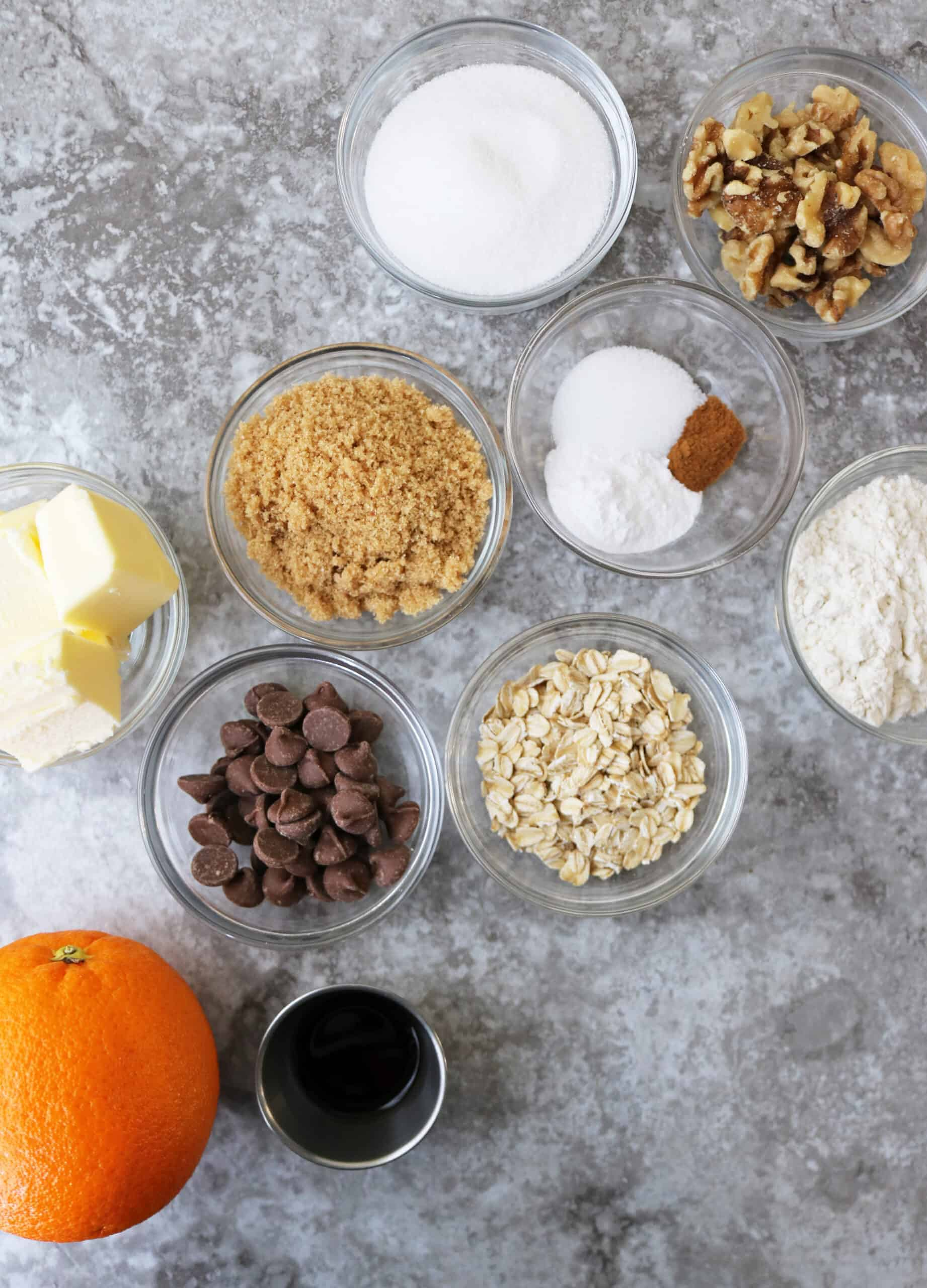 Image of all the ingredients needed to make chocolate chip cookies with orange.