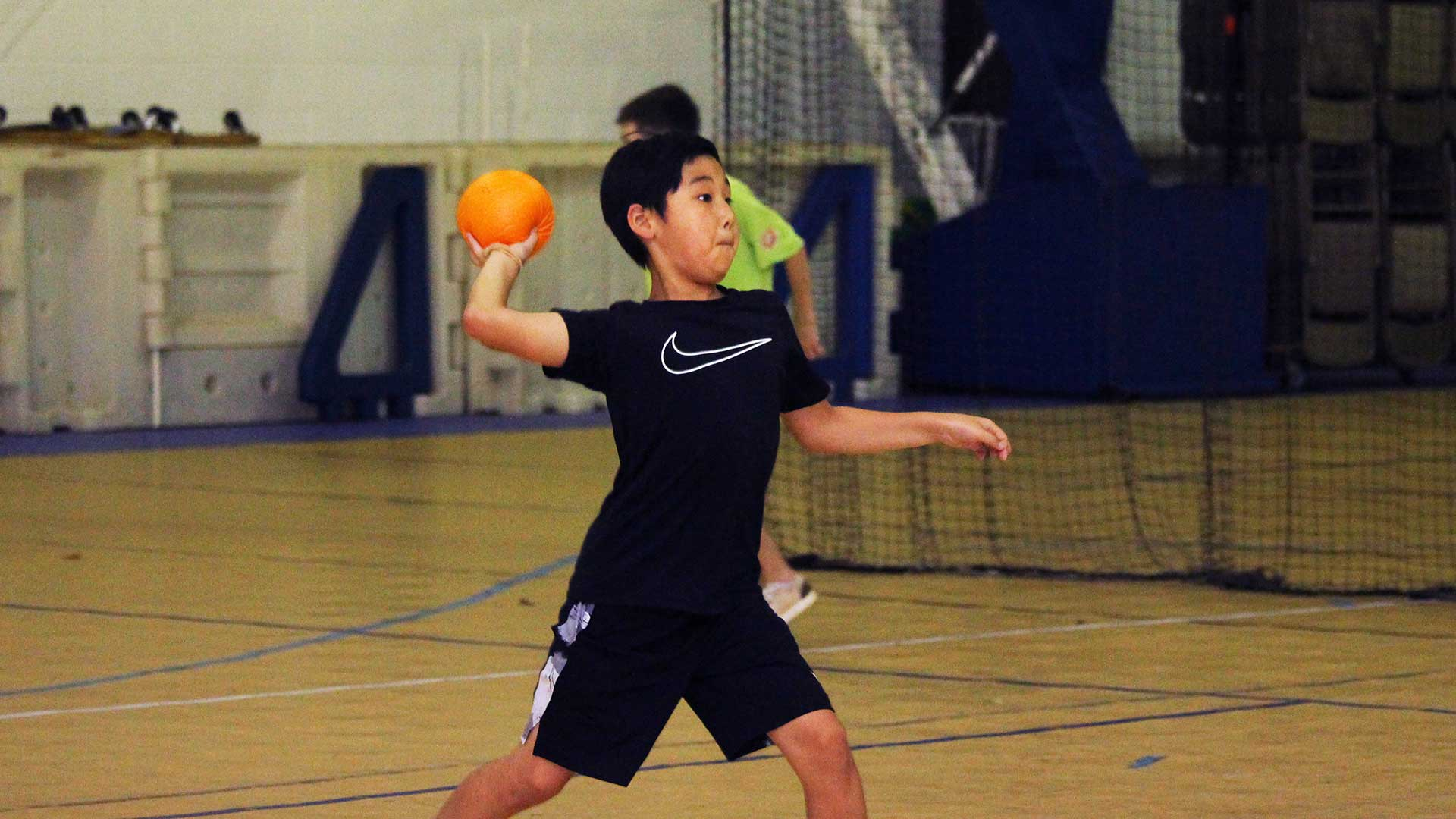Young boy throwing a ball