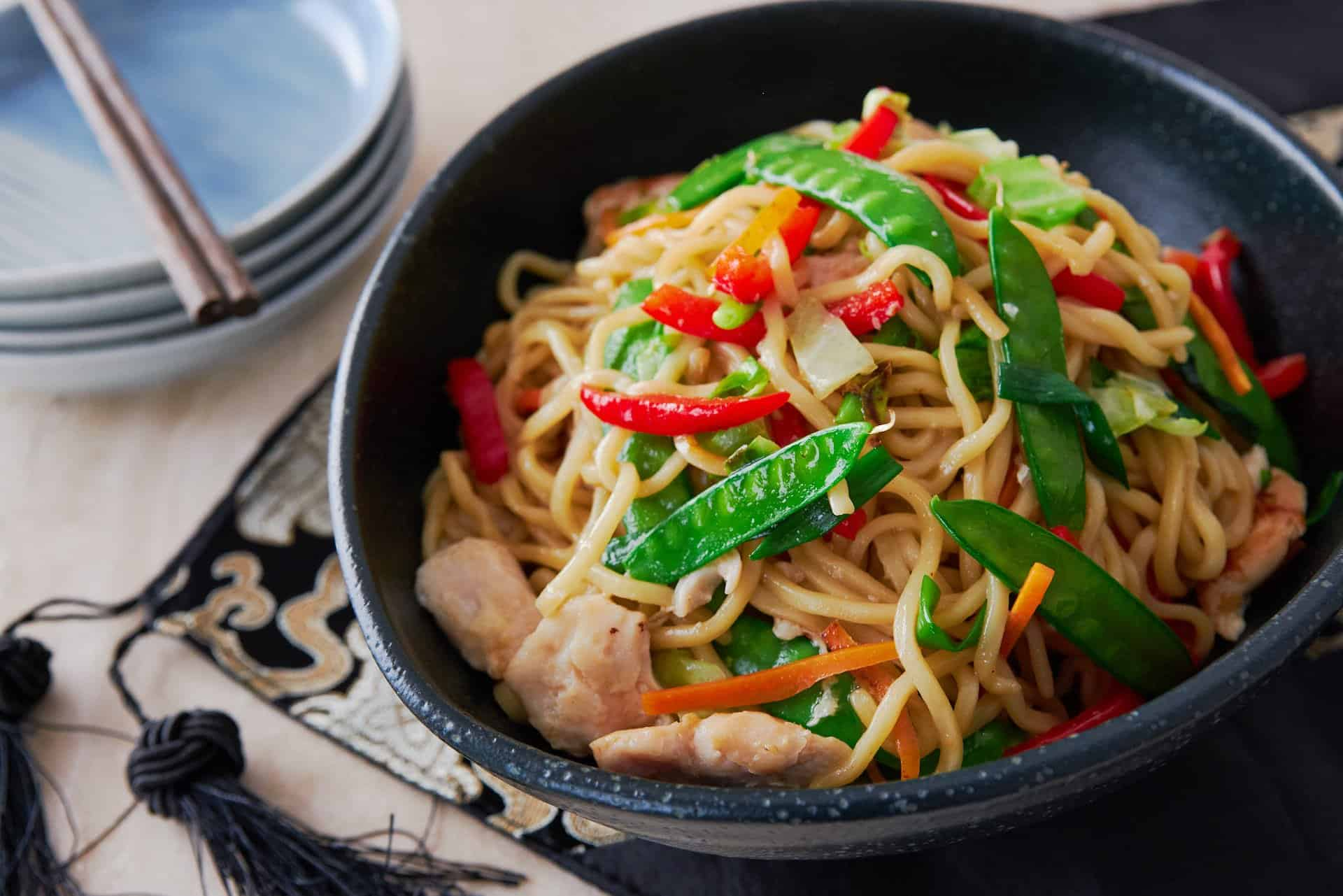 With a medley of fresh crisp veggies and juicy flavorful chicken, stir-fried with a tangle of savory noodles, this Chicken Chow Mein recipe is simply delicious.