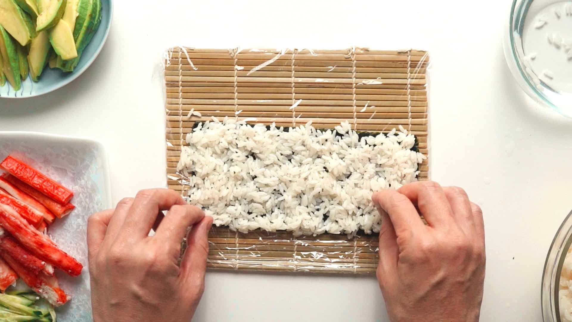 Spread the rice using the tips of your fingers.