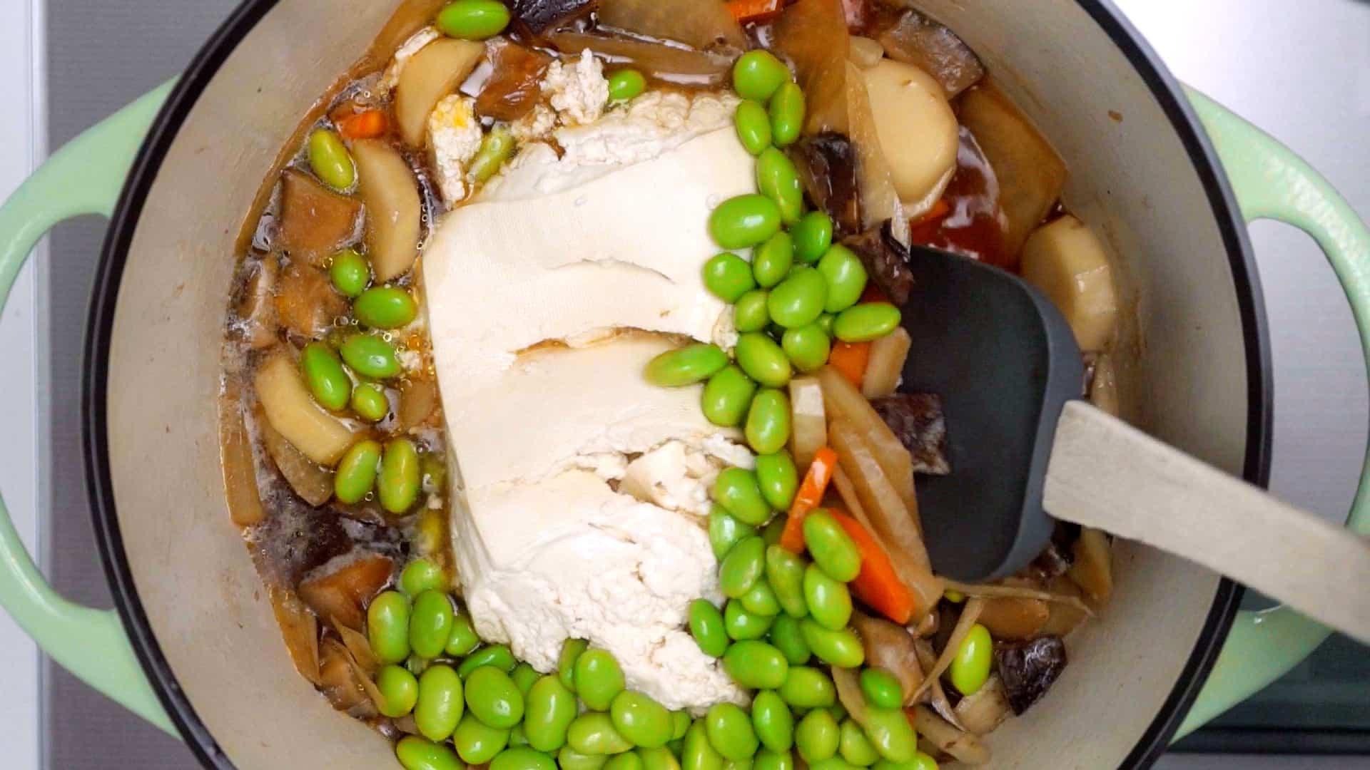Tofu and edamame added to Japanese vegetable soup.