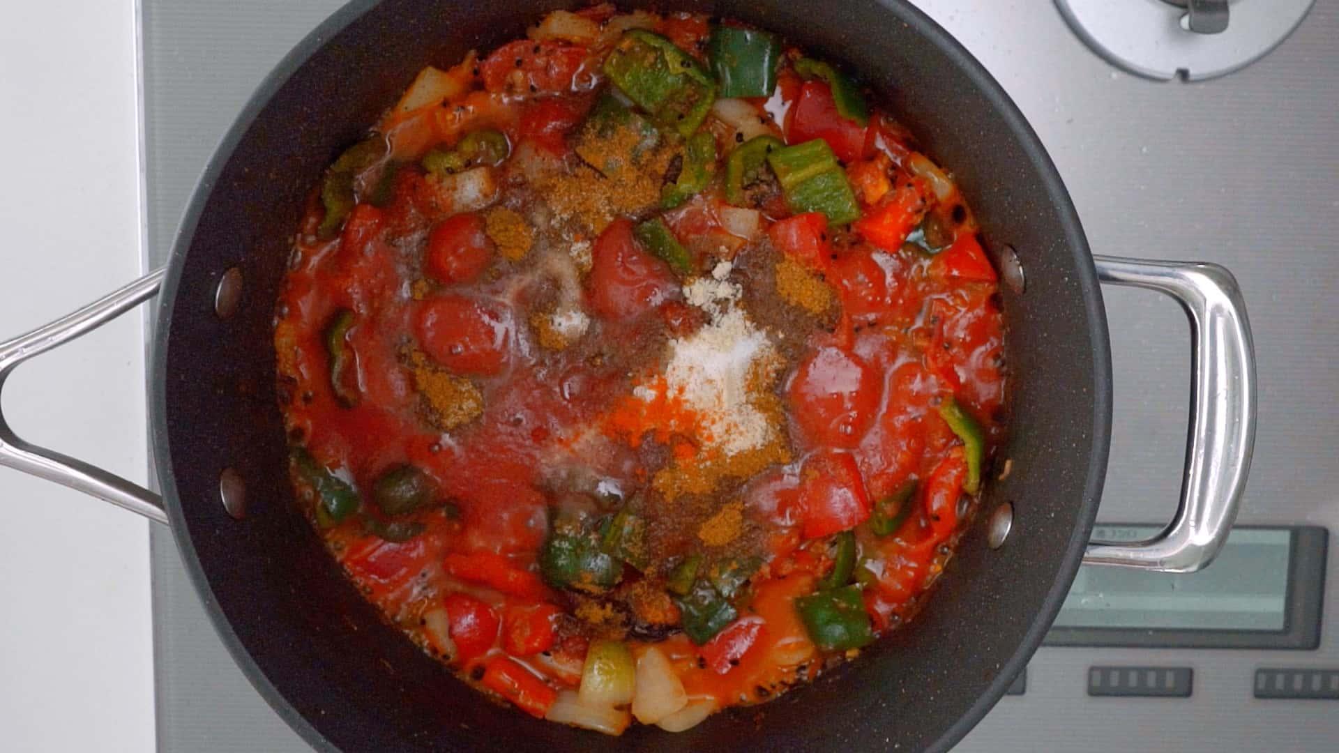 Garam masala, salt, and cayenne pepper added to Chicken Jalfrezi.