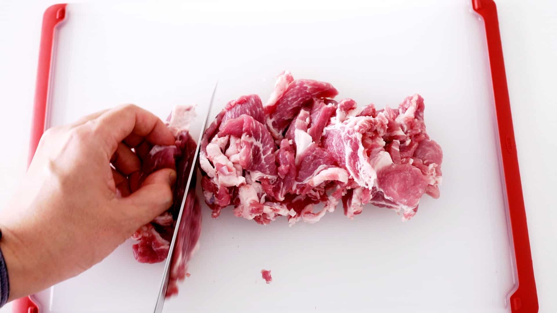 Slicing pork shoulder thinly for making Japanese Ginger Pork.
