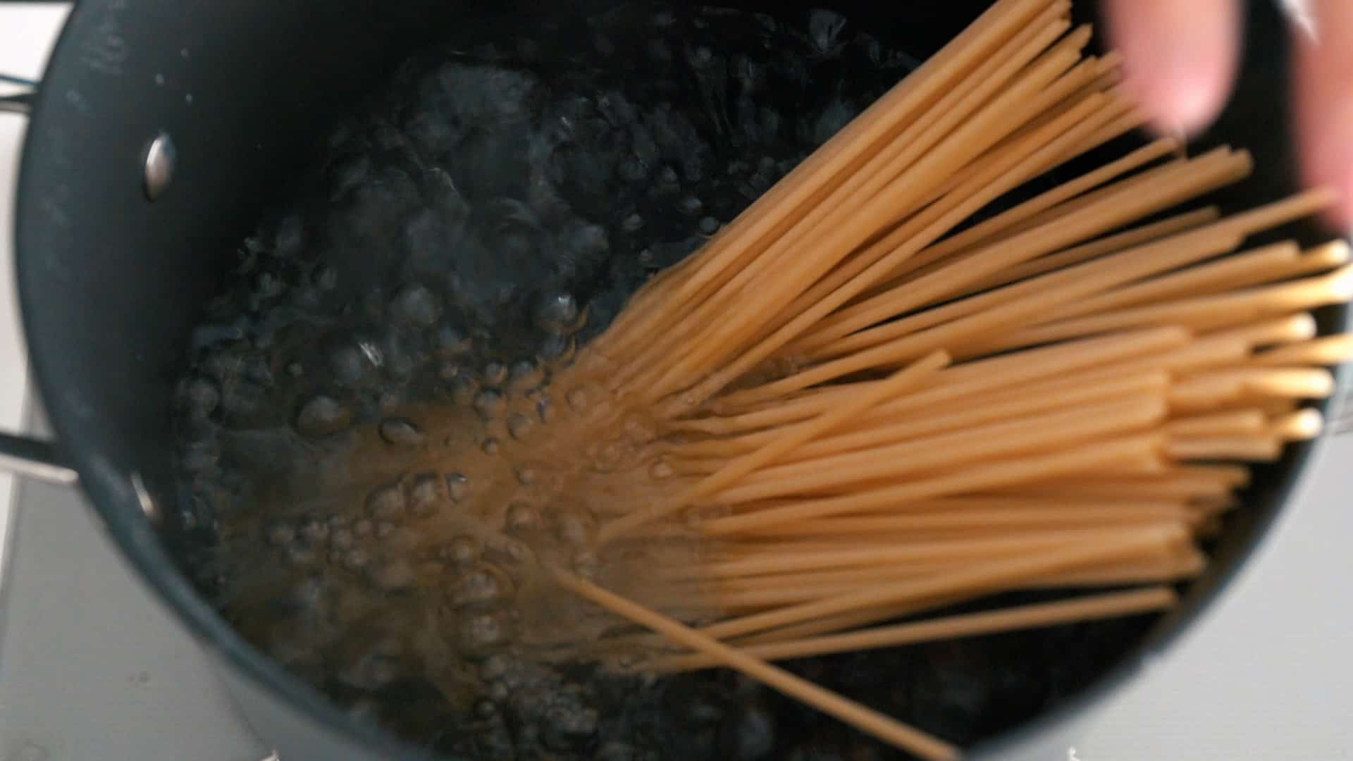 Boiling Bucatini in a pot of salted water.