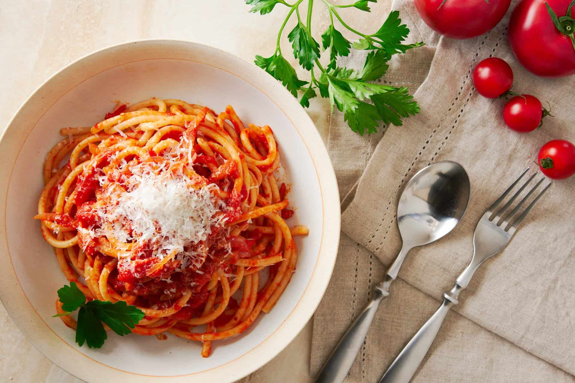 With Guanciale and Pecorino Romano cooked in tomato sauce, Bucatini all'Amatriciana is a mouthwatering pasta that comes together in a matter of minutes.