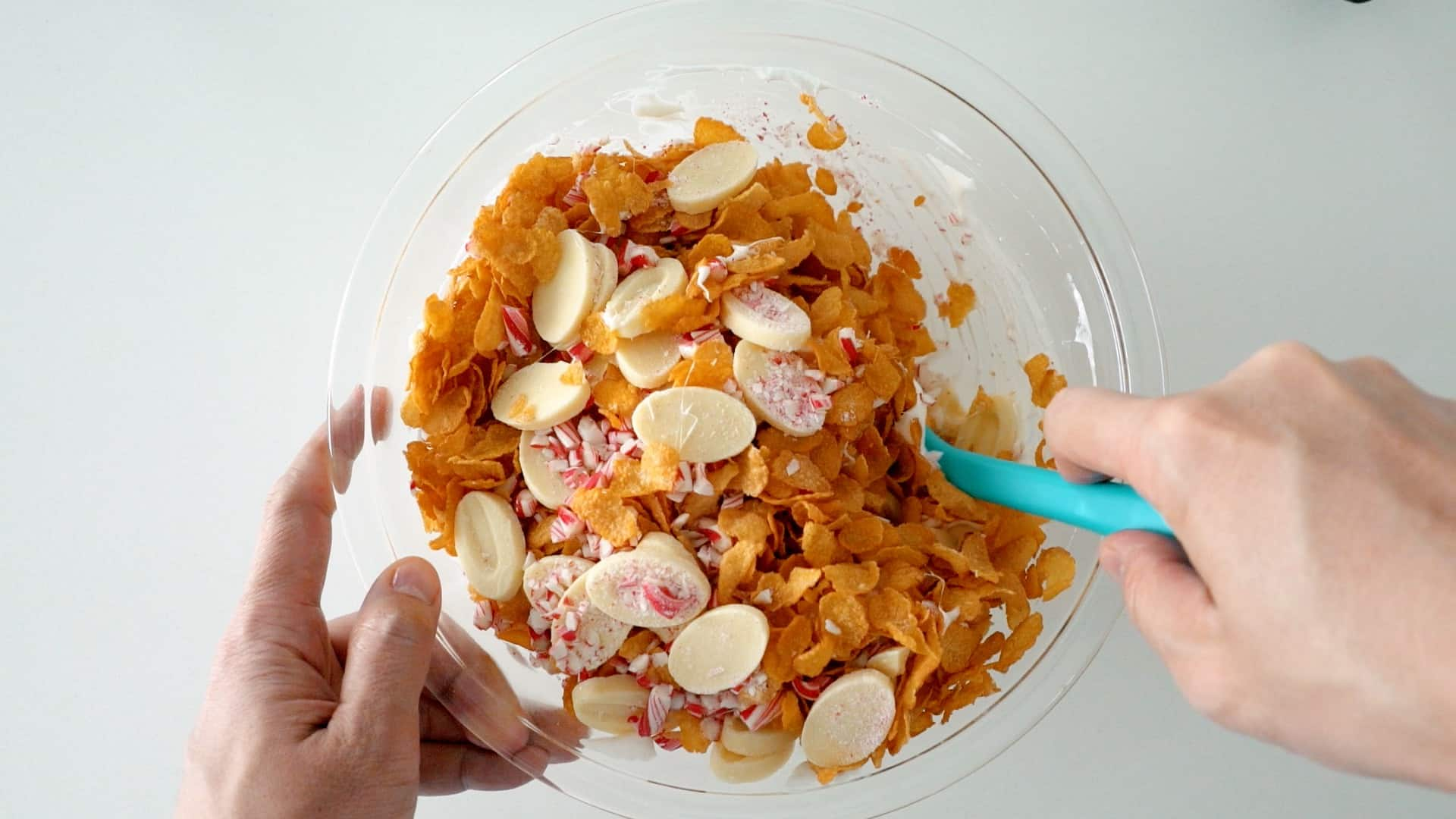 Add the cornflakes, crushed candy cane and white chocolate to the marshmallow mixture and stir.