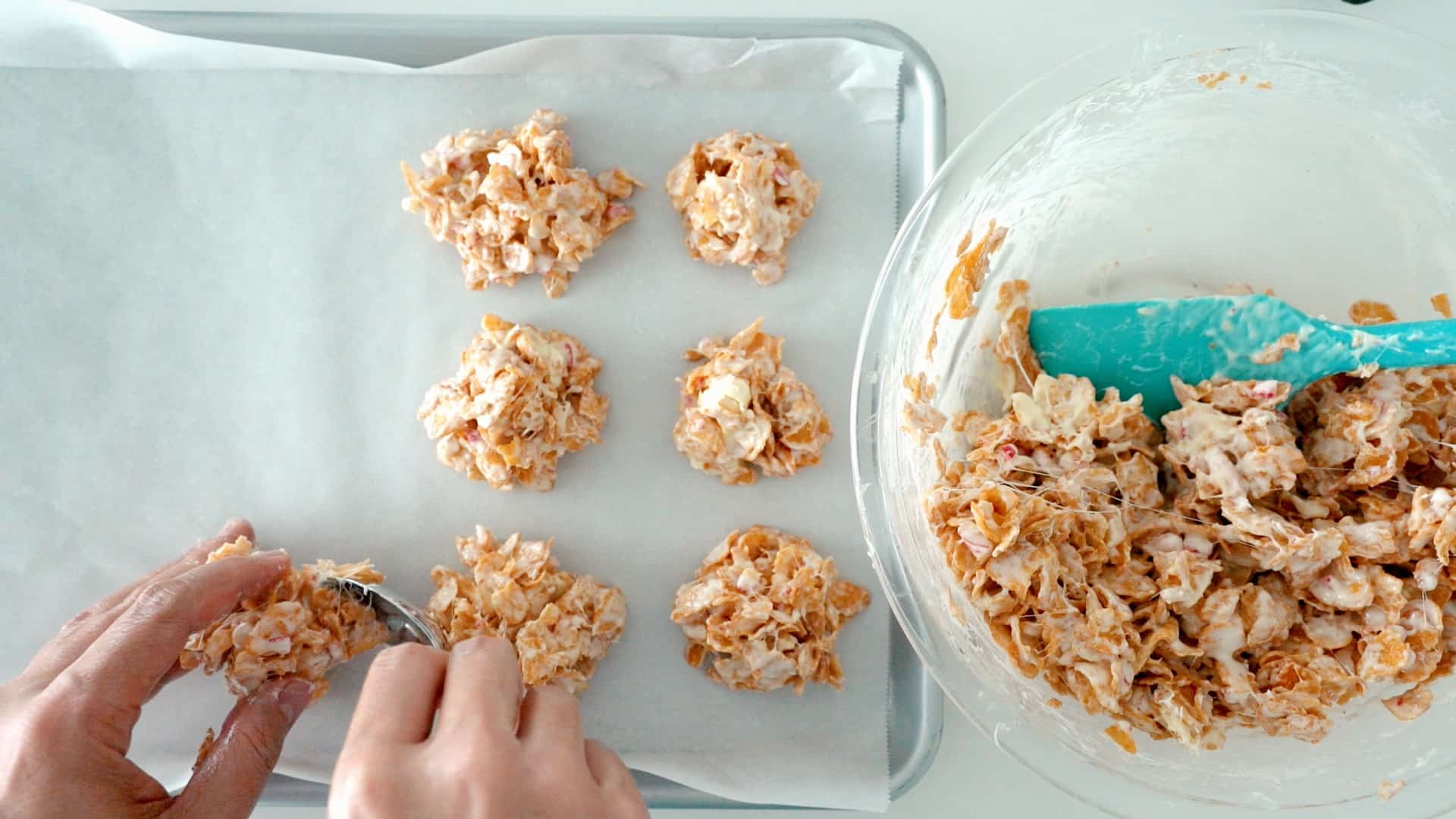 Shaping crispy peppermint bark into cookies.