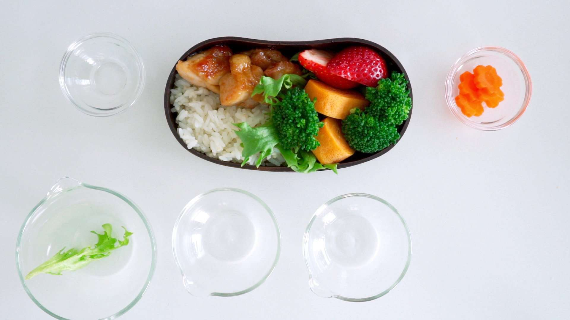 A strawberry is added to the Ginger Chicken Bento.