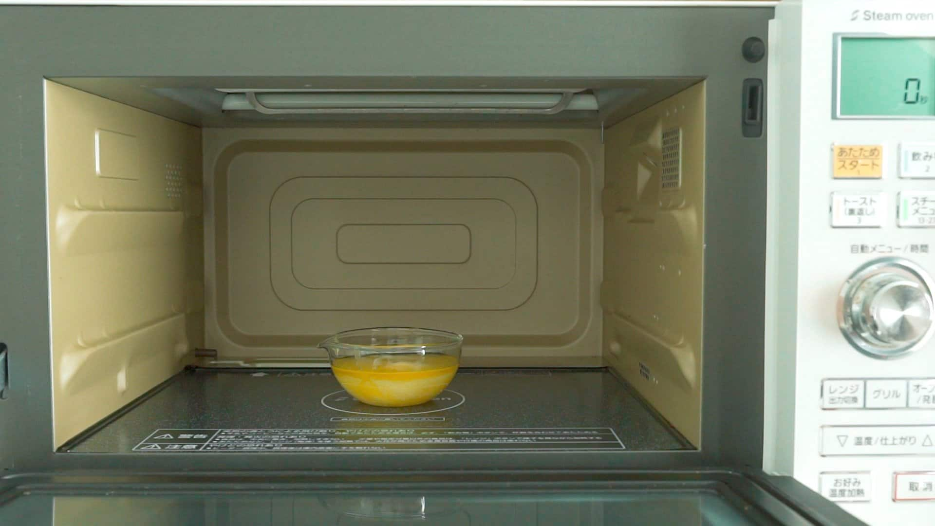 Melting butter in the microwave to make banana bread.
