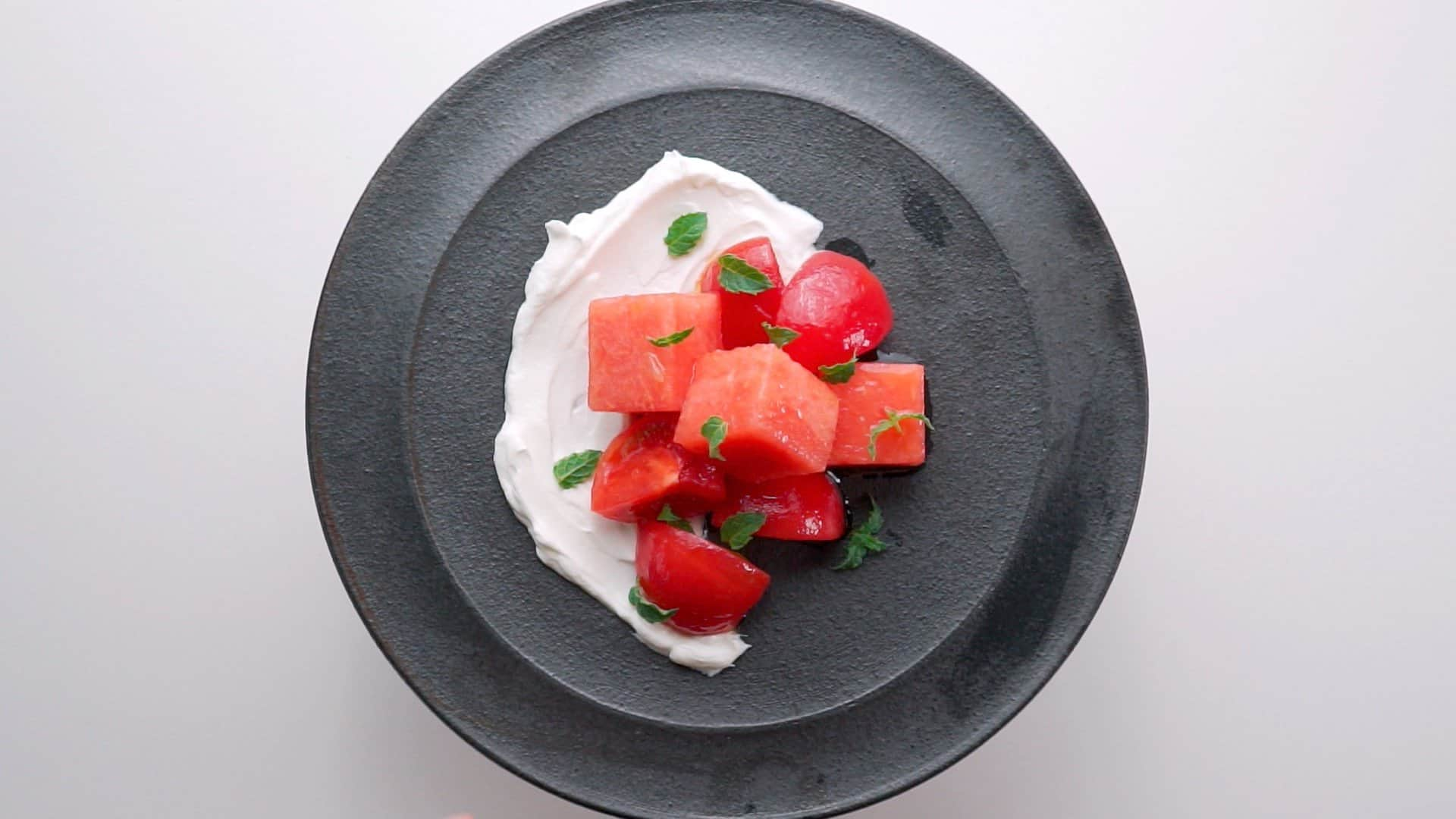 Mint, watermelon and tomato salad on a bed of labneh.