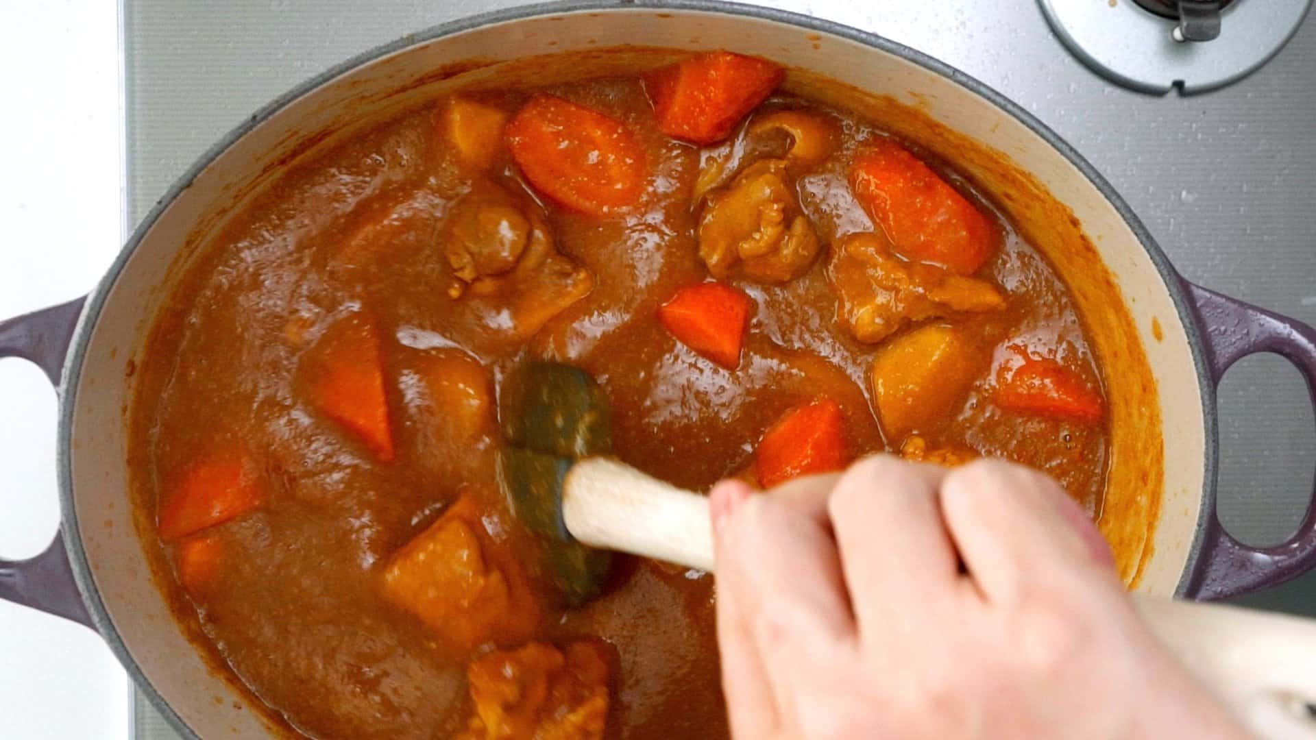 As the curry cooks down it takes on a darker color.