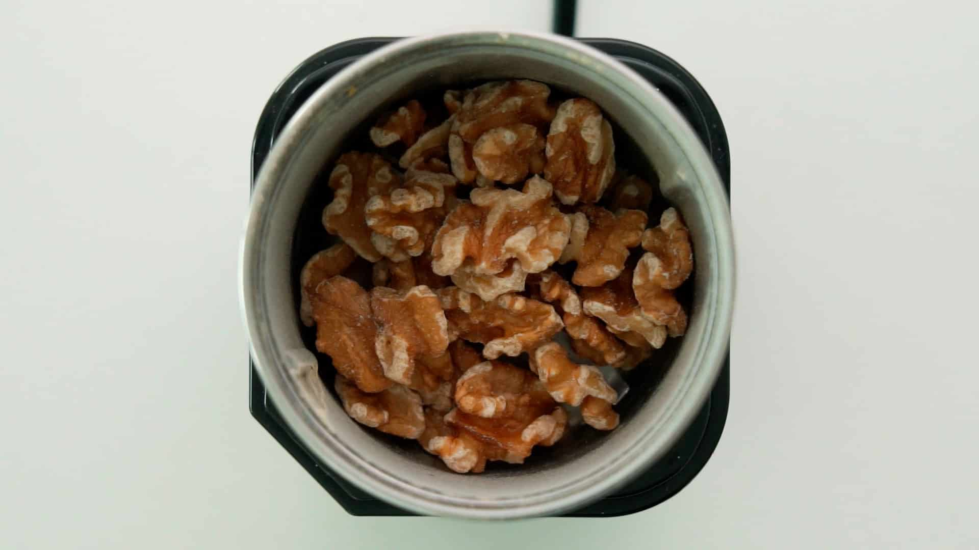 Walnuts in spice grinder.