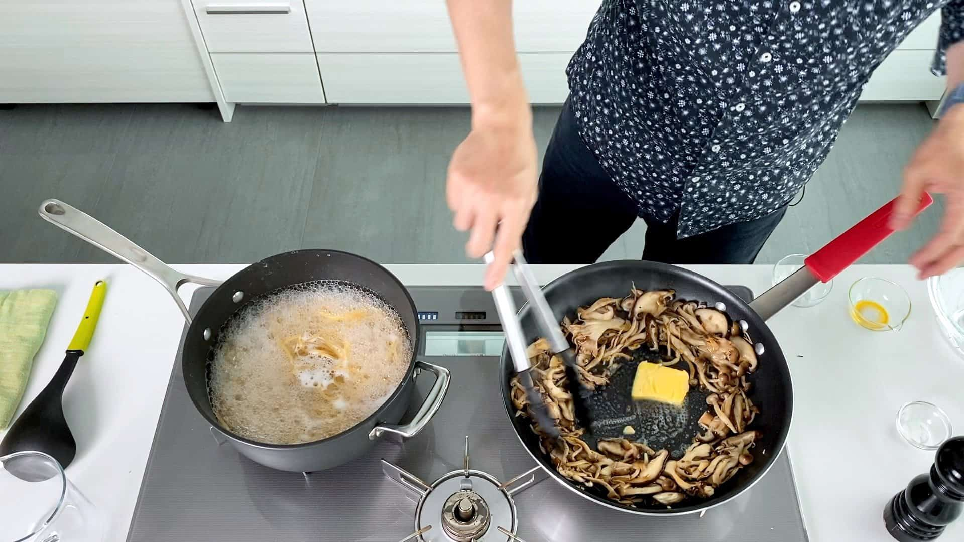 Adding butter to fried mushrooms.