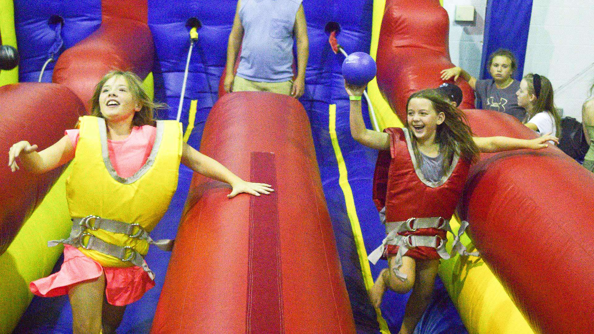 Two girls on inflatable bounce house