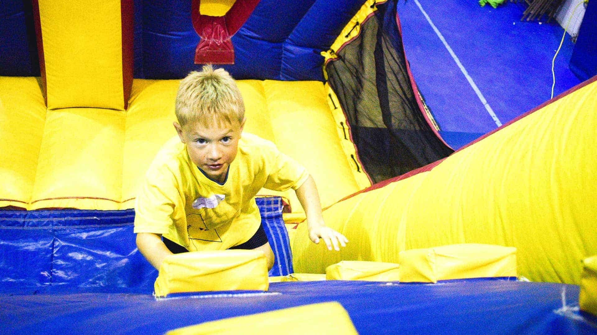 Young boy on inflatable bounce house