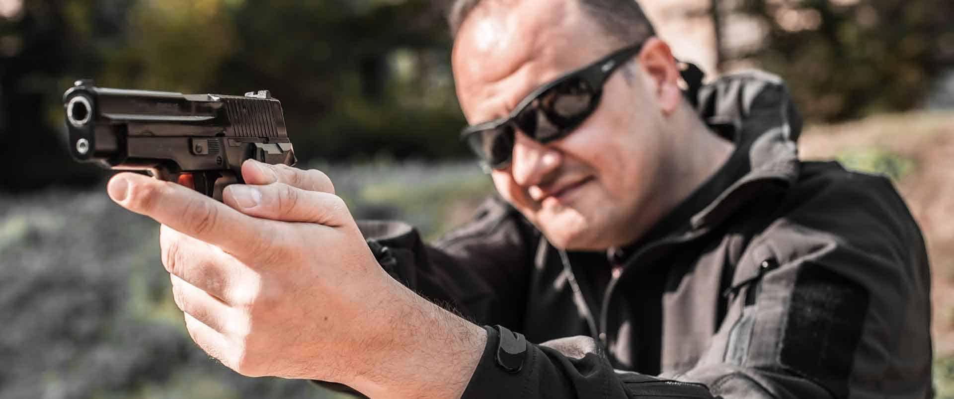 Armed bodyguard target practicing