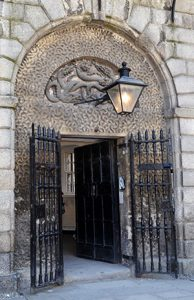 The Front Door of Kilmainham Gaol with the Hydra Motif visible above the door. - The Irish Place