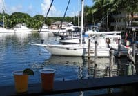 Skippers Dockside in Key Largo includes a view of a wide canal with boats, pelicans and, the historic African Queen steaming past.