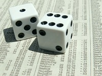 gambling-stock-dice-newspaper