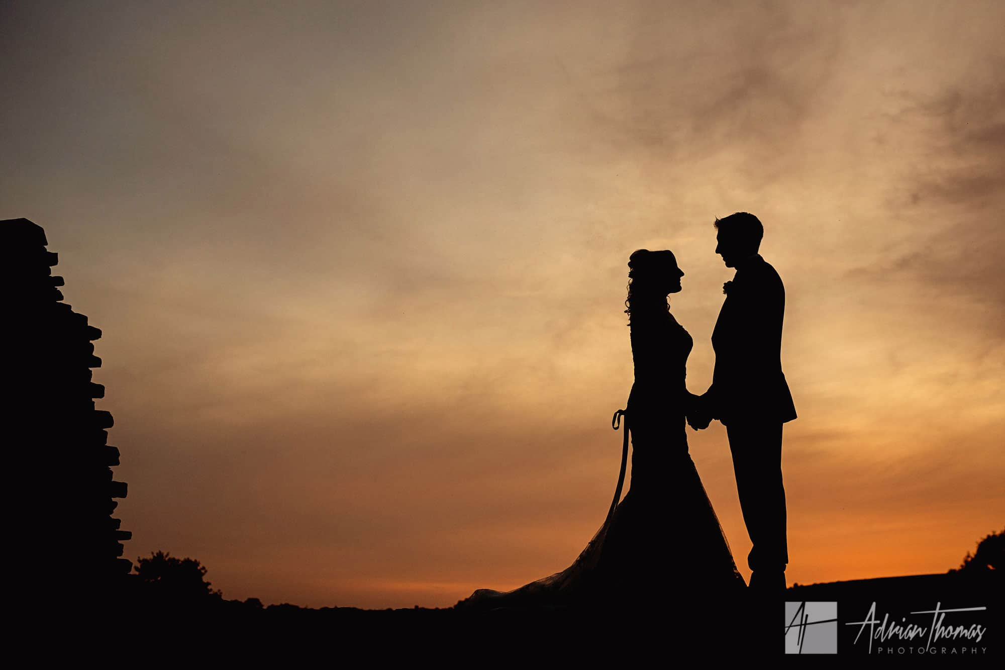 Image of bride and groom during silhouette at Caerphilly Castle Wedding