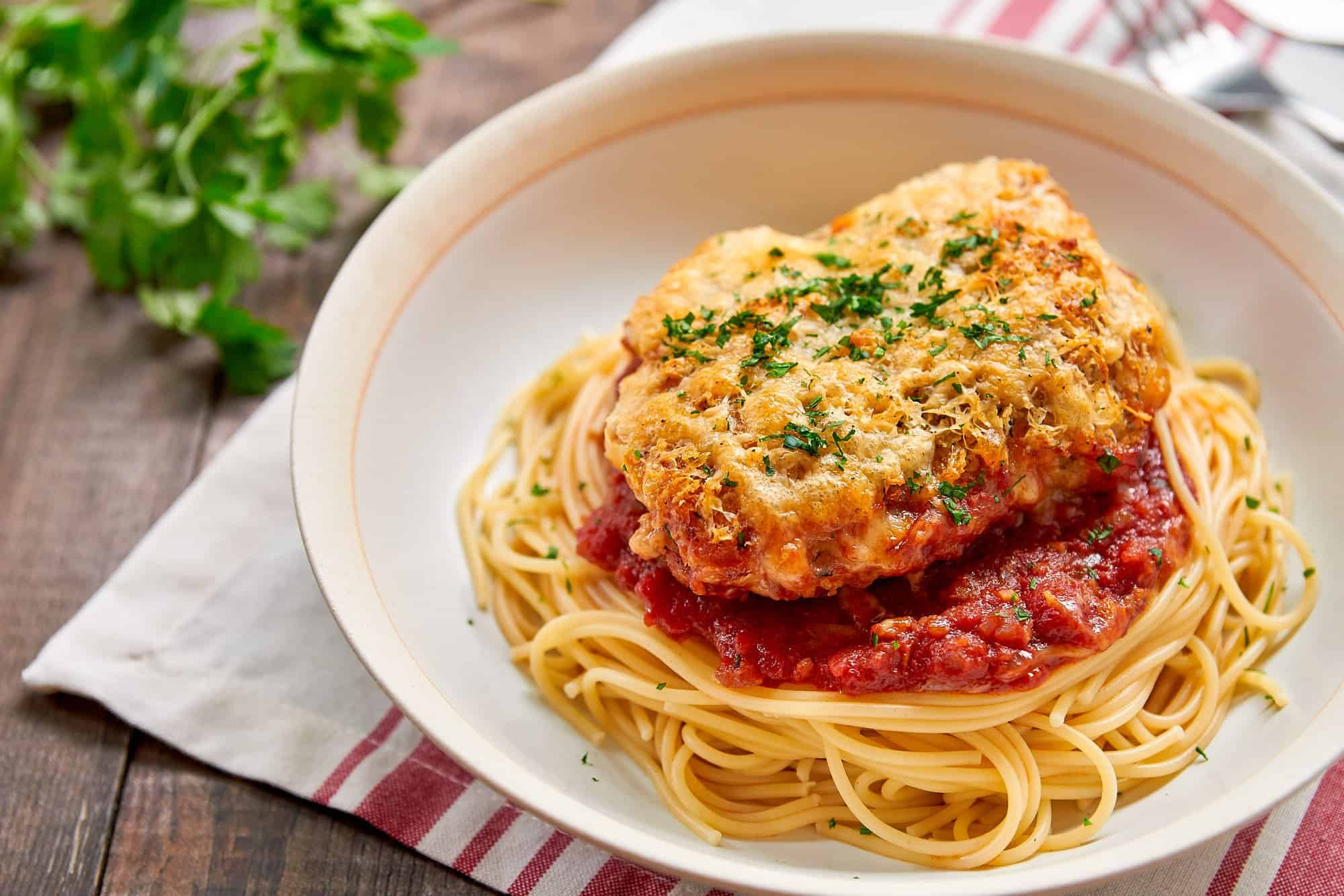 With crisp seasoned breadcrumbs and cheese on top and savory sauce on the bottom, this easy chicken parmesan is irresistably good.