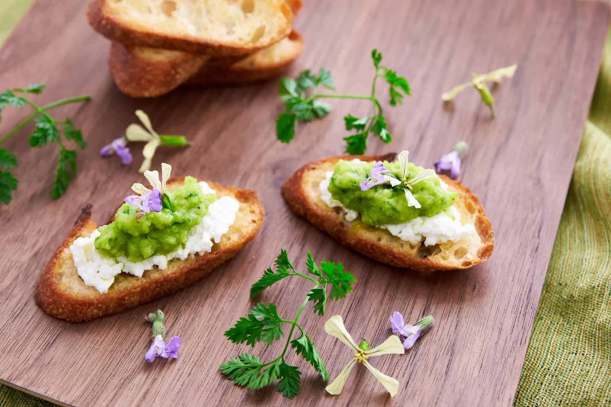 Perfect spring green pea pesto with ricotta spread on crostini.