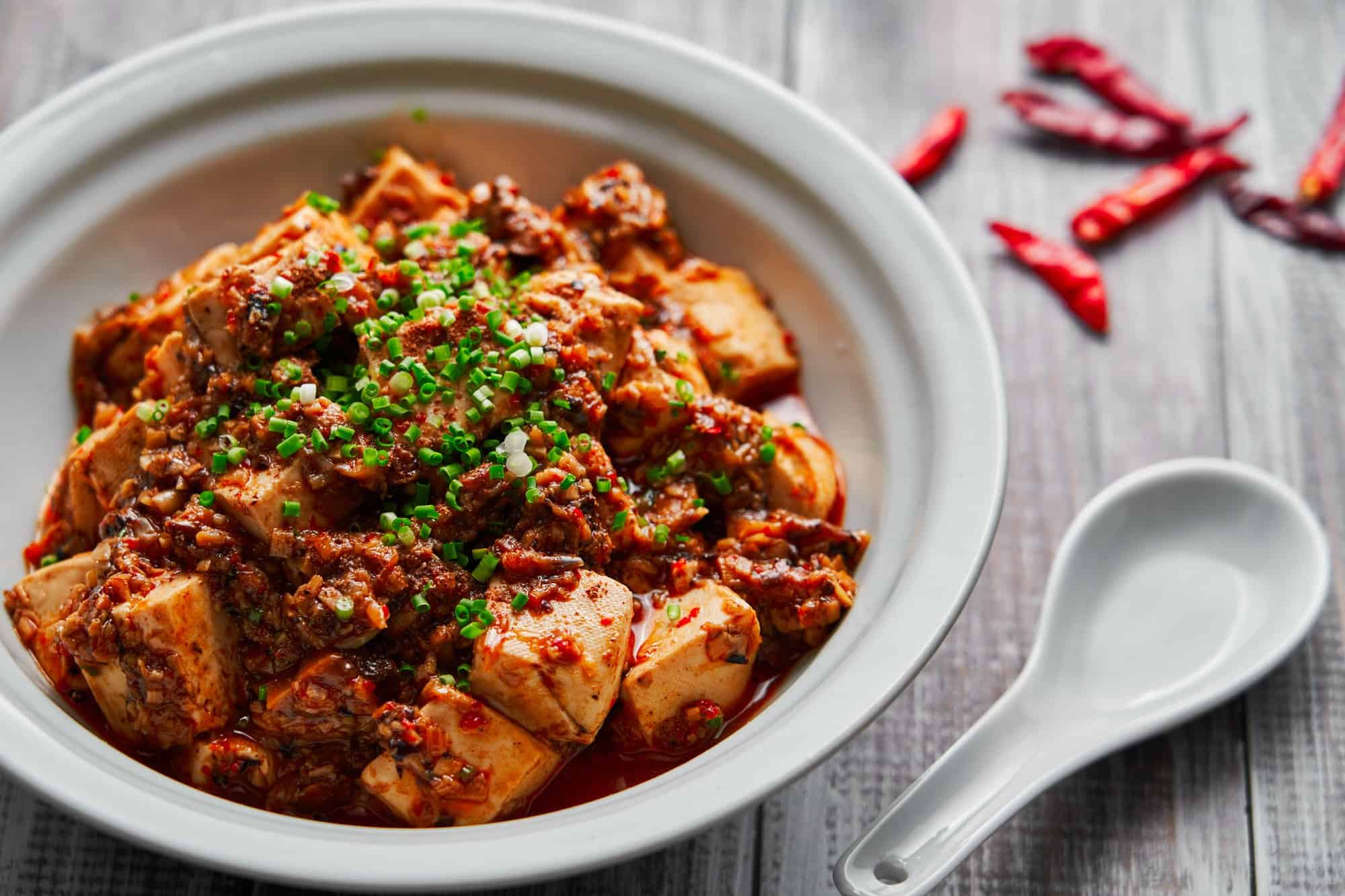 """With loads of aromatics and mushroom ground """"meat"""" in the red hot sauce, this vegan Mapo Tofu is brimming with savory umami."""