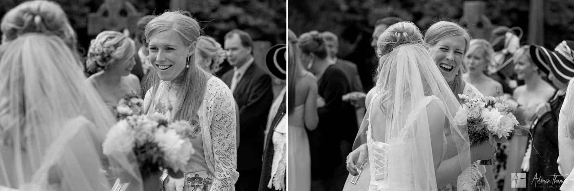 Bride greeting guests outside church.