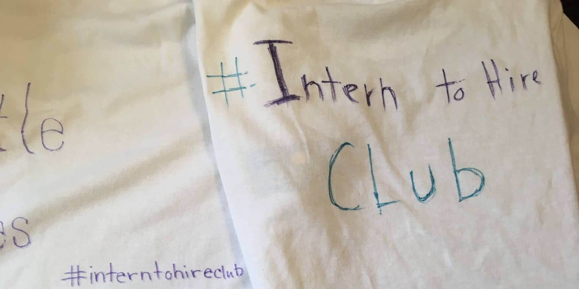 """Intern to Hire club"" on white t-shirt"