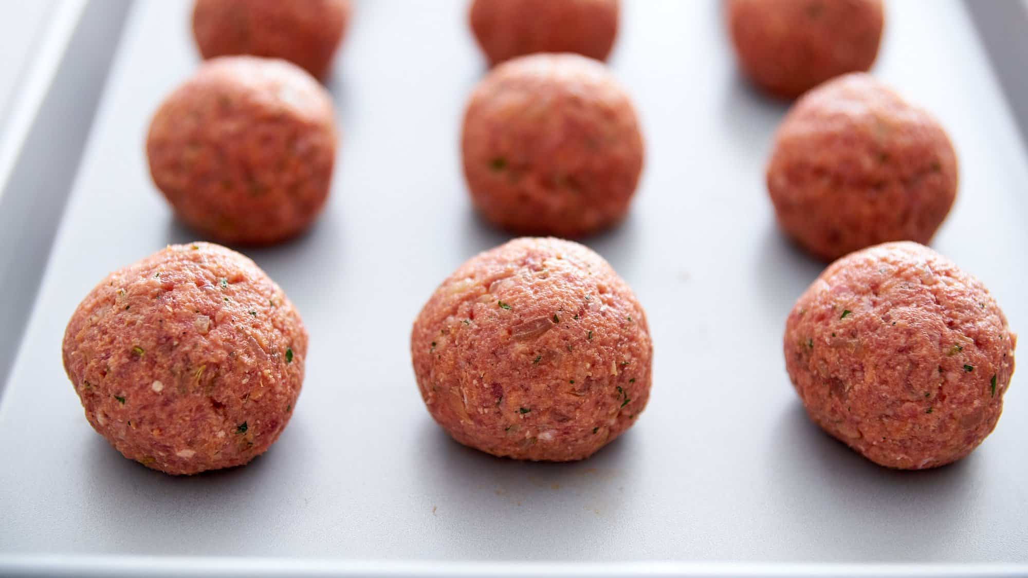 Shape the meatballs into spheres.
