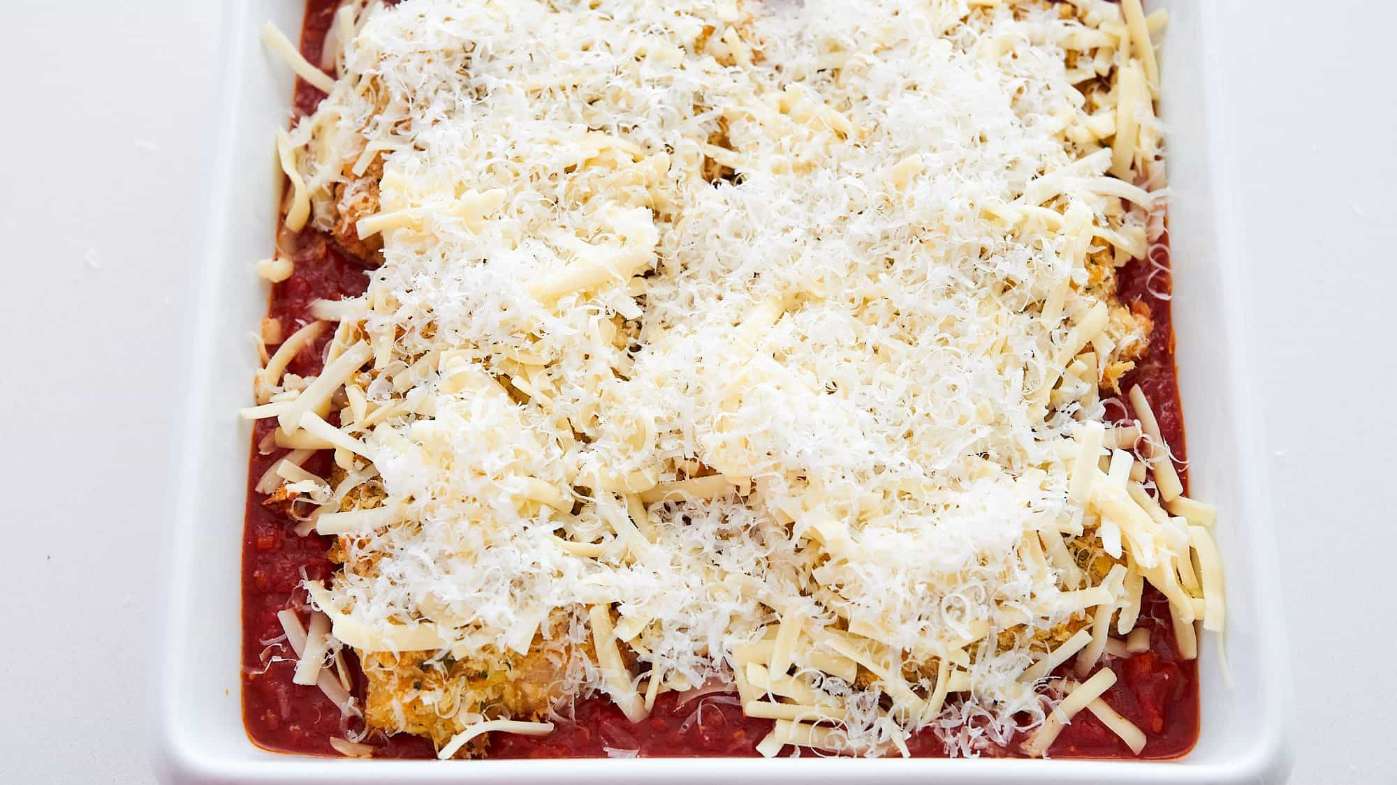 Cover the chicken parmesan with mozzarella and parmesan and bake.