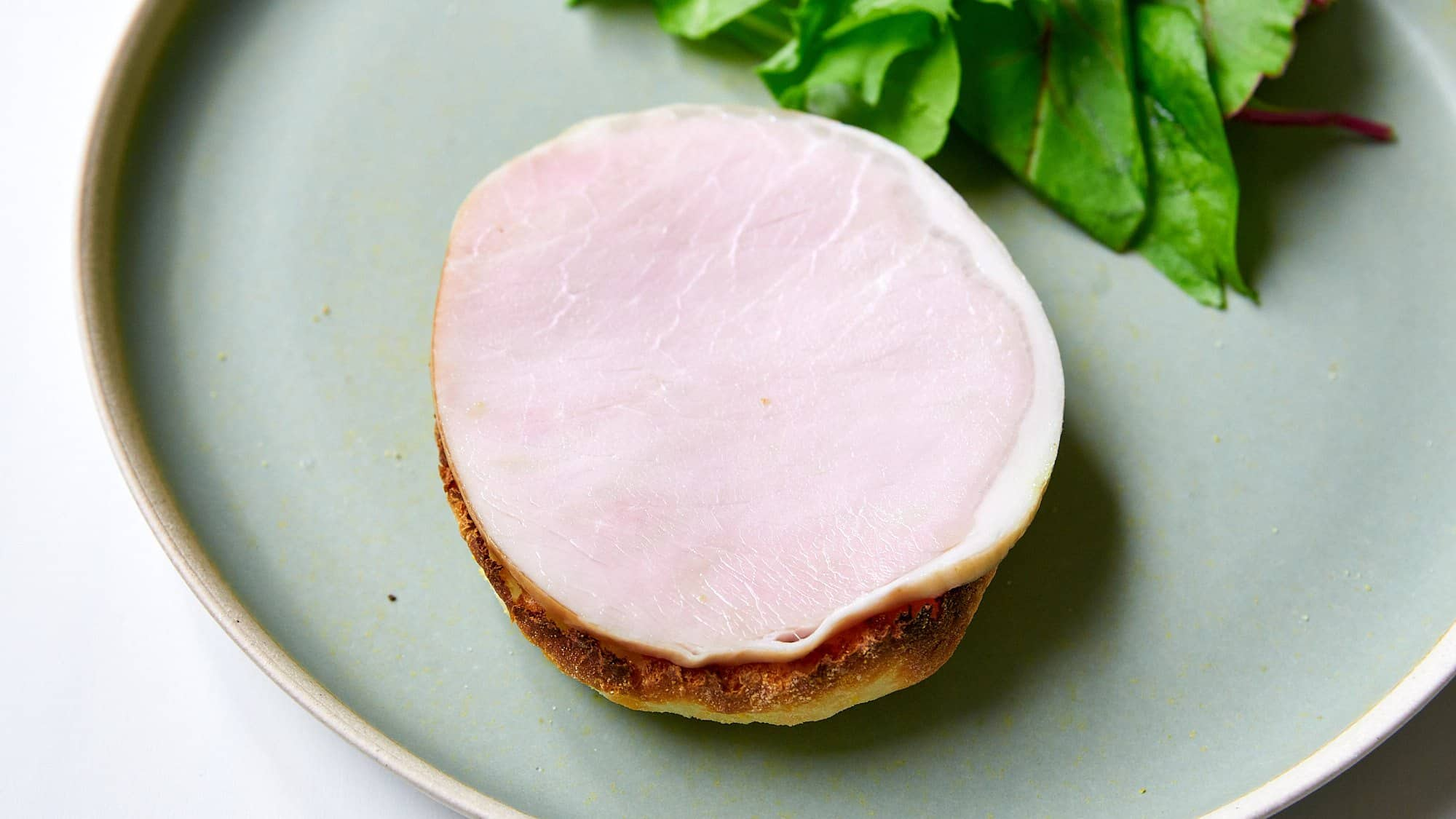 The next component of Eggs Benedict is a thick-cut slice of ham.