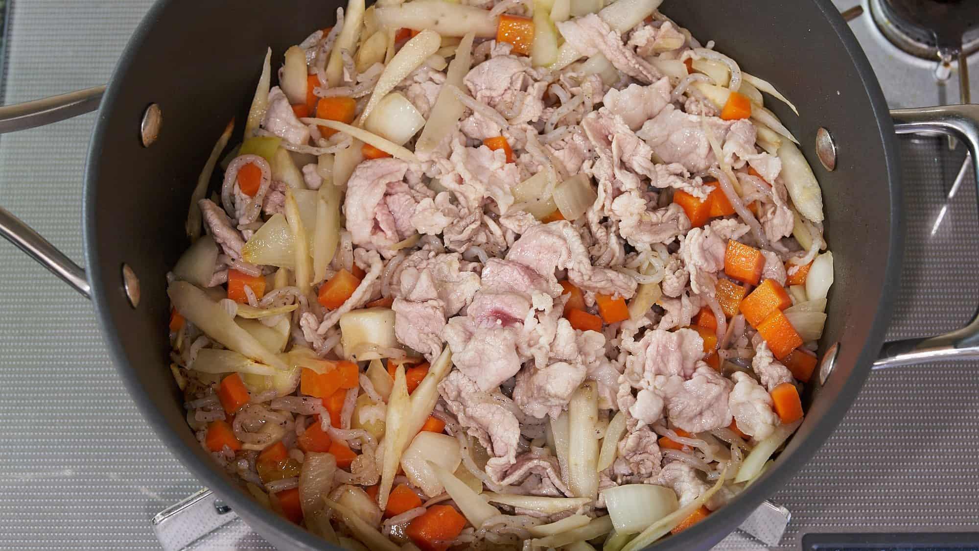 Add pork and saute before adding water to make tonjiru.