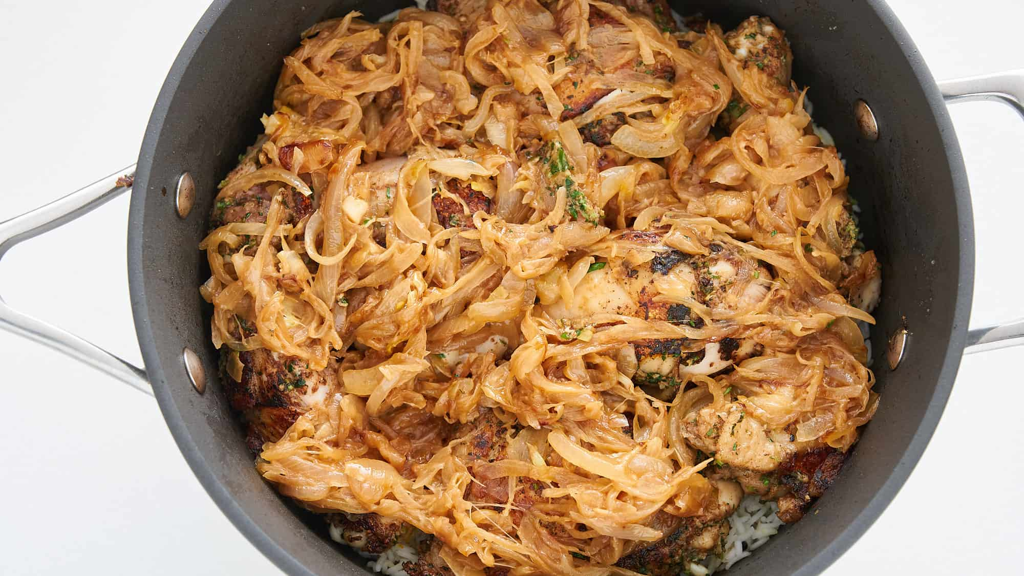 A layer of caramelized onions goes on top of the chicken for the Biryani.