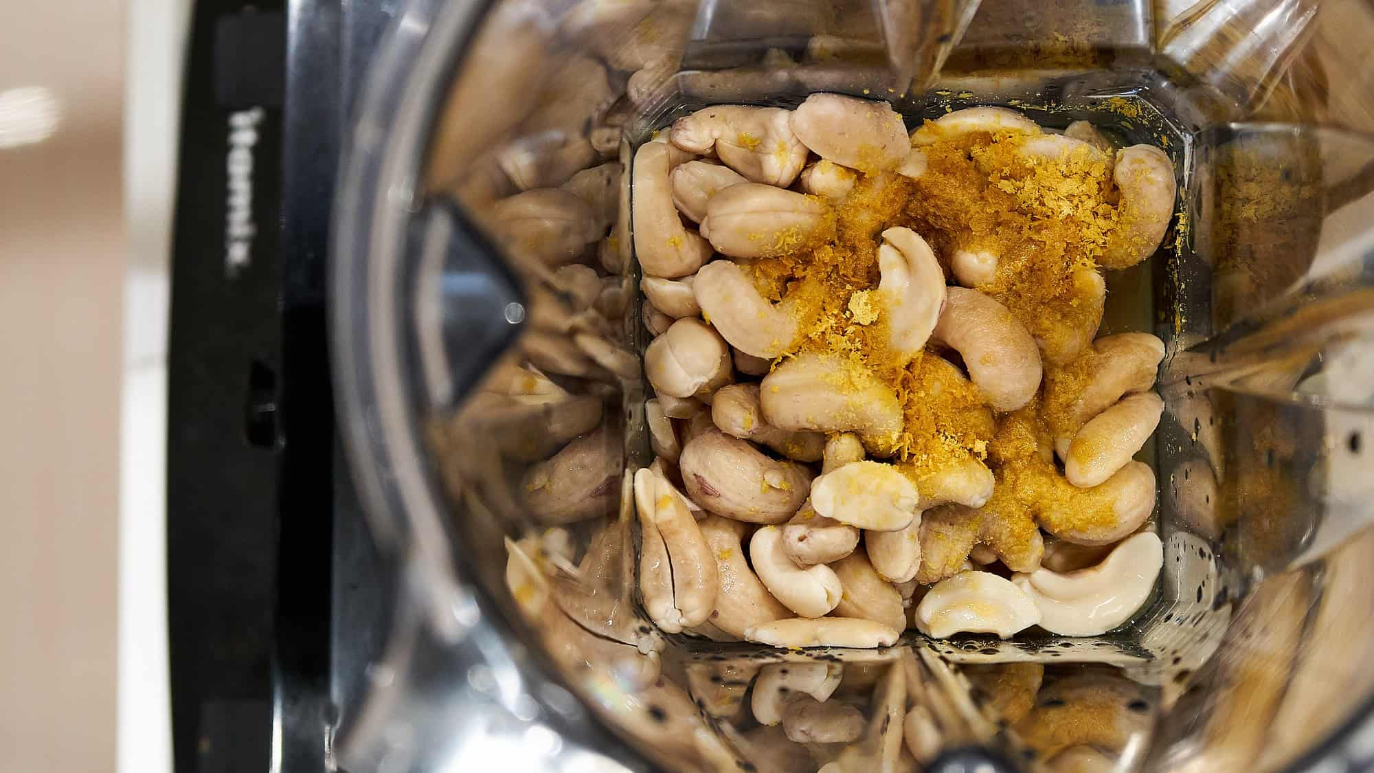 The boiled cashew nuts go into a blender with nutritional yeast, soy sauce, salt and lemon juice to make a creamy plant-based French onion dip.