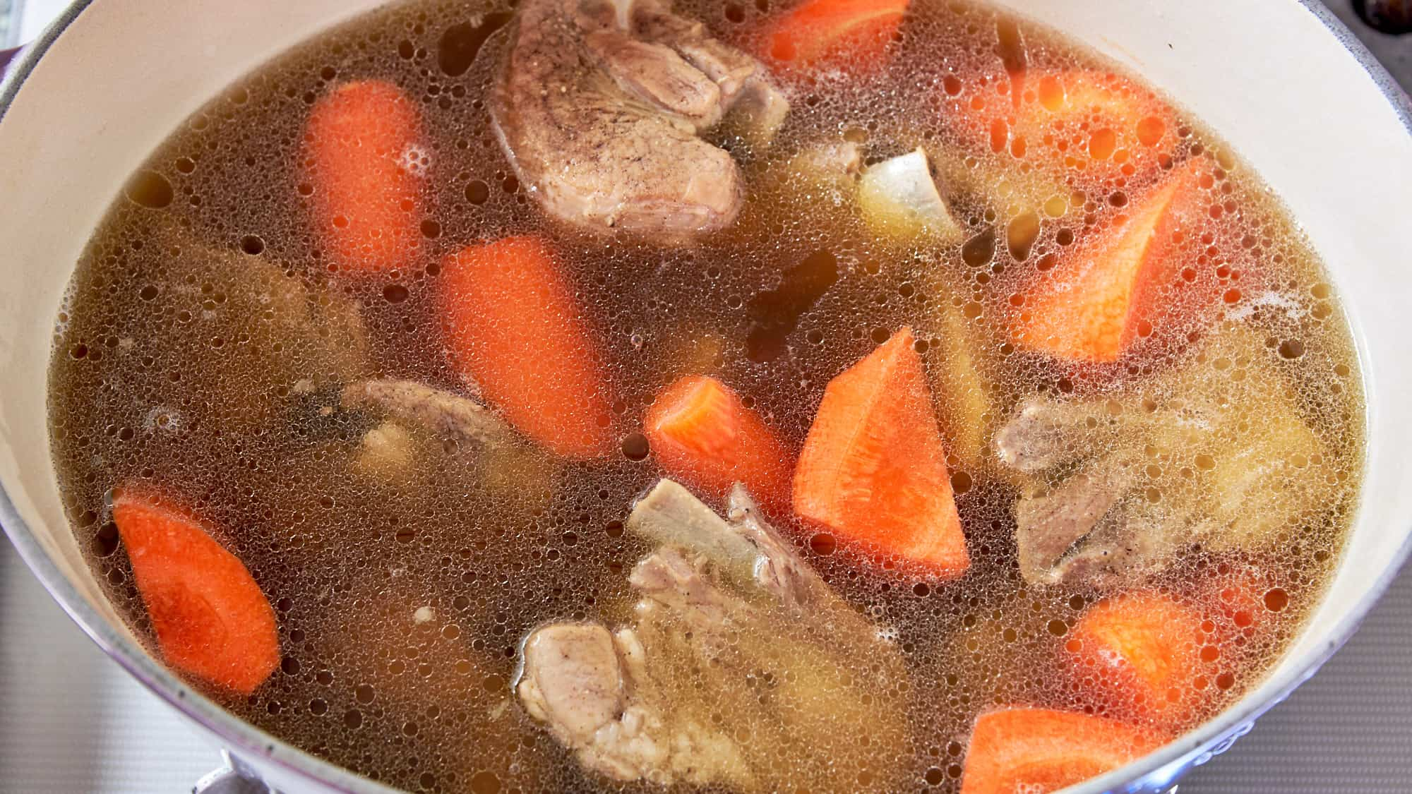 Tender spareribs, and stock returned to Dutch oven with strained stock for making Pot au Feu recipe.