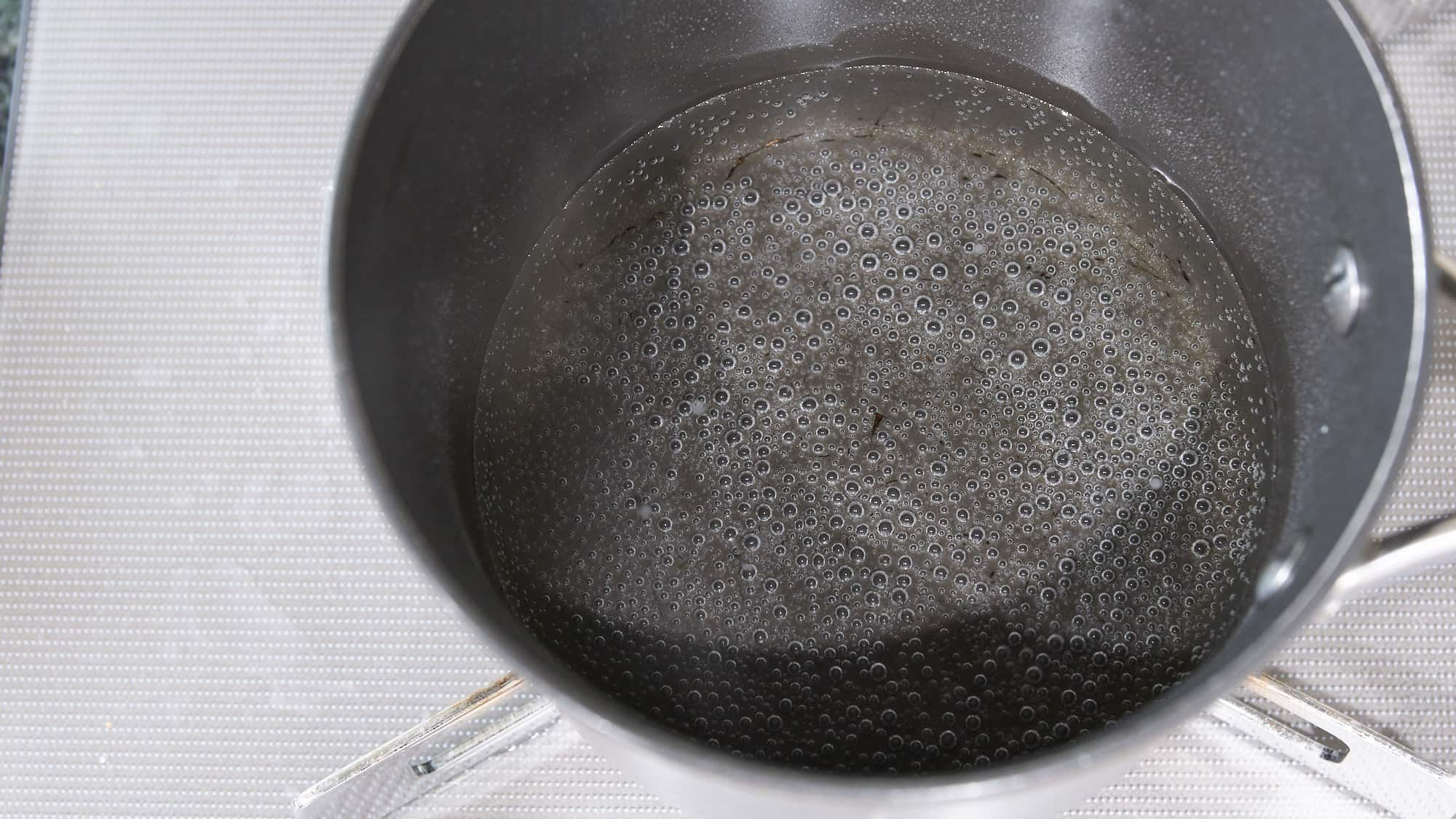 Brine for ramen egg in pot on stove.