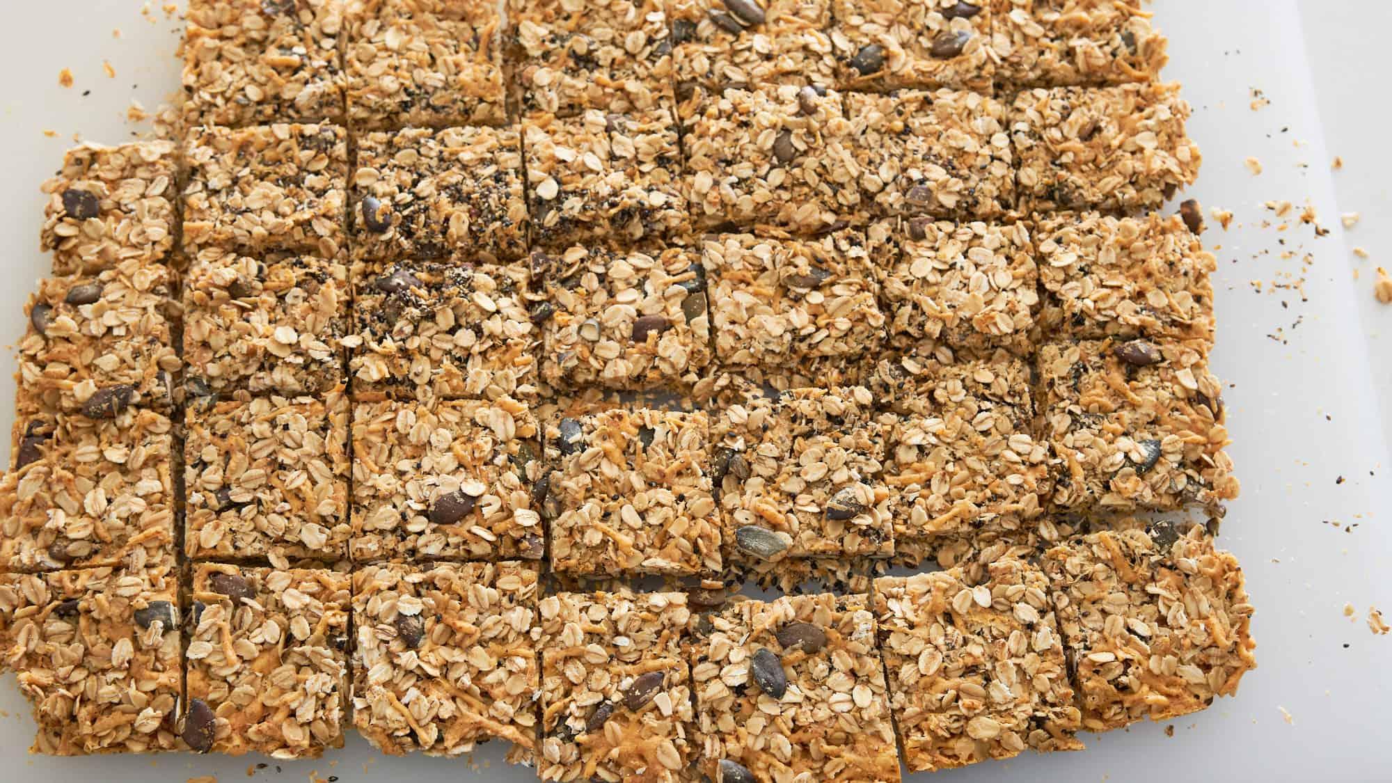 Savory granola cut into square granola bars on a cutting board.