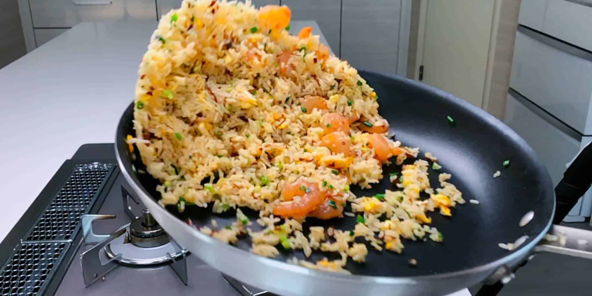 Tossing Shrimp Fried Rice in a frying pan.