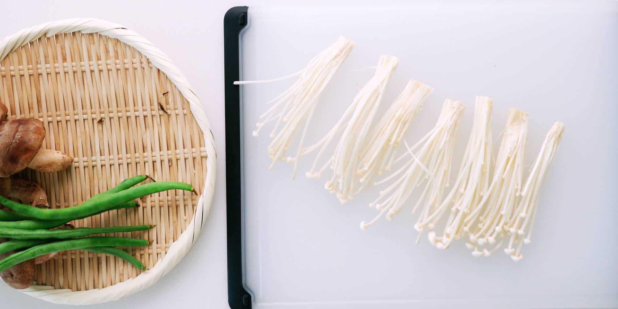Enoki mushrooms separated into clusters for tempura.