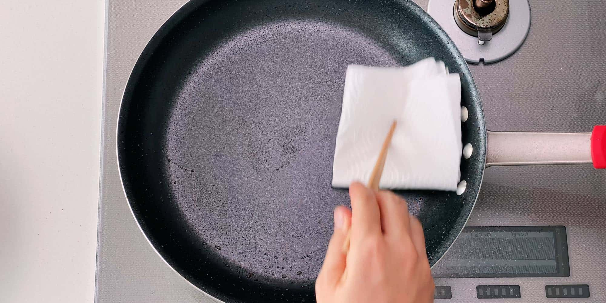 Wiping out the oil from the pan before glazing the pork.