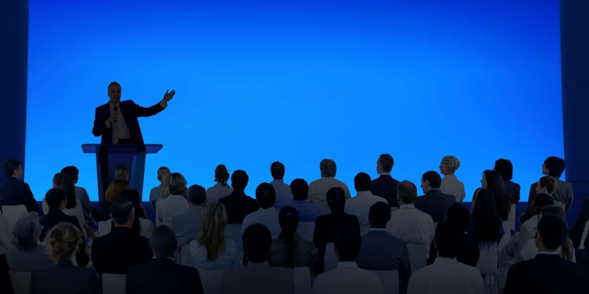 maxiom tech CEO Antonio Chagoury speaks at a convention
