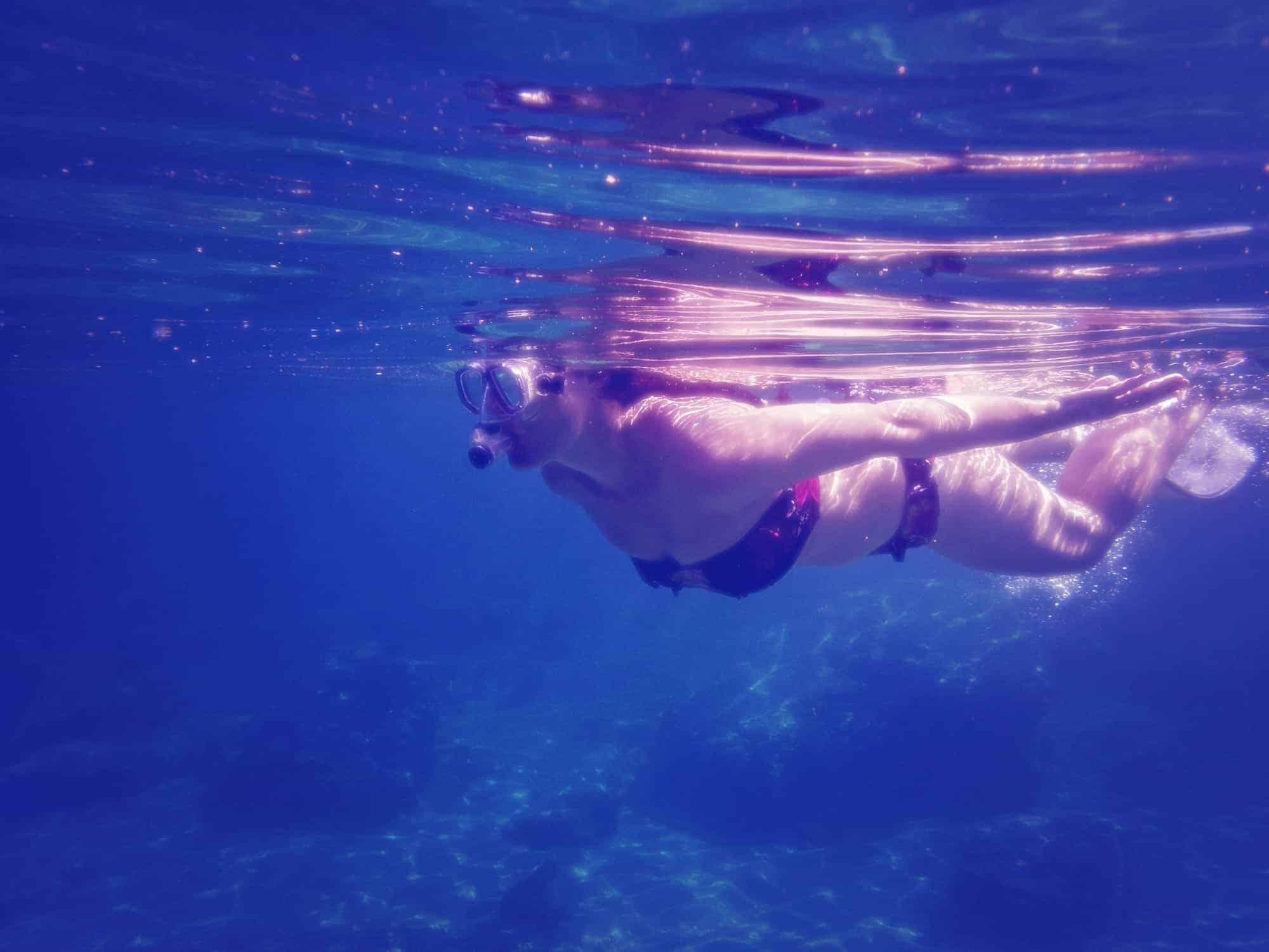Lady underwater snorkelling