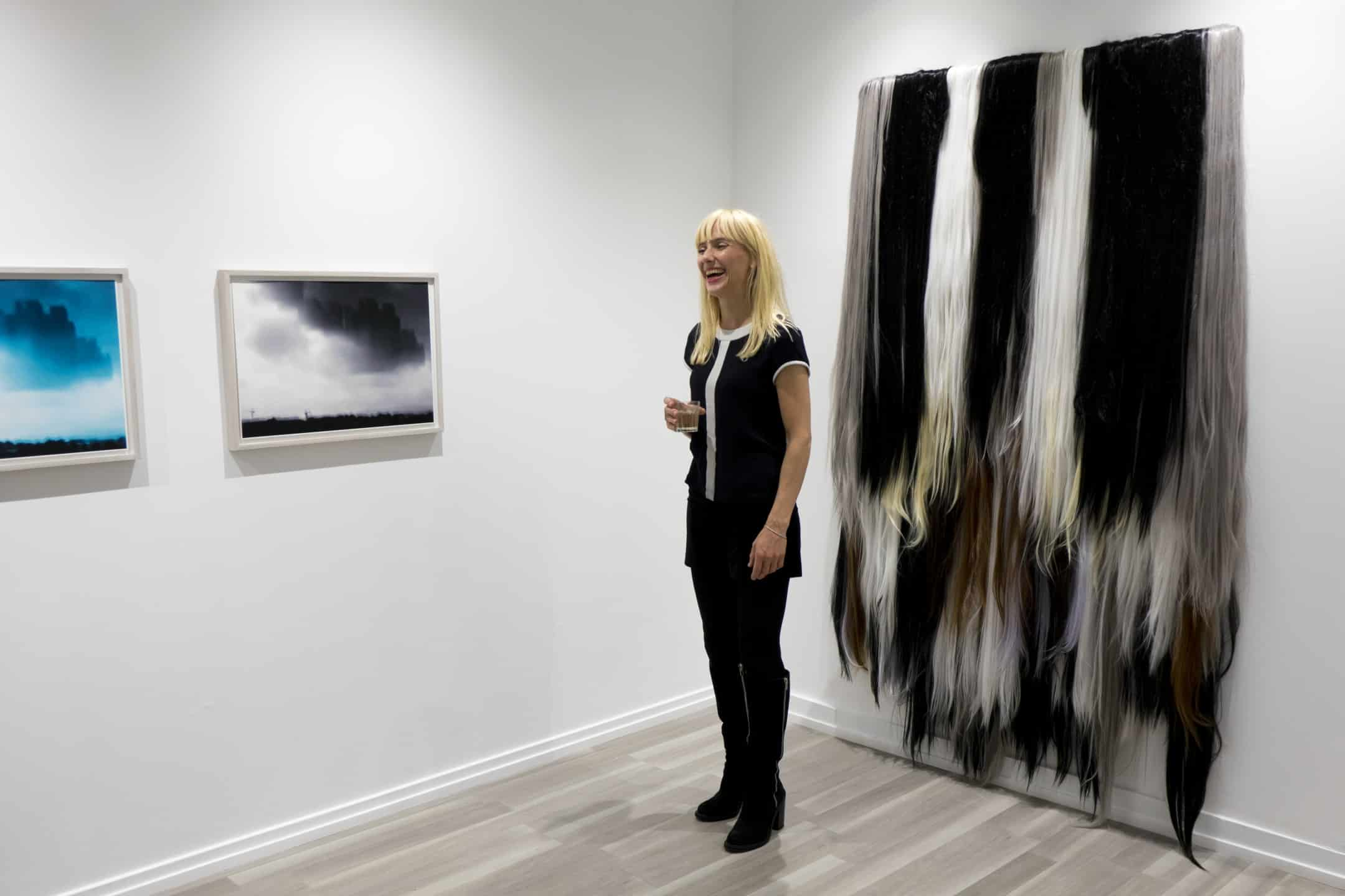 Josefine Lyche at the opening of her solo show The Worlds Darkening Never Reaches To The Light Of Being,  at QB Gallery in 2016 (courtesy of artandculture.no)