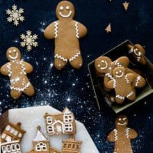 Gingerbread biscuits made into houses and gingerbread men