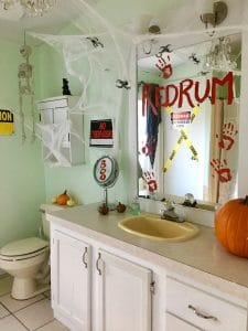 redrum and bloody prints on bathroom mirror