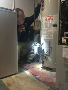 Inspecting Water Heater - BHI