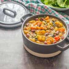 Curry in a grey casserole dish with a lid