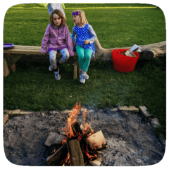 children by campfire