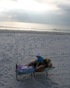family on beach, enjoying madeira beach, madeira beach florida, florida, money saving travel tips
